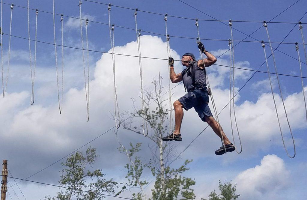 man climbing at the North Shore Adventure Park