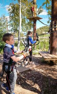 Practice the always-locked-on safety system at the Adventure Park