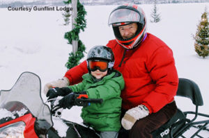 Family snowmobiling at Gunflint Lodge