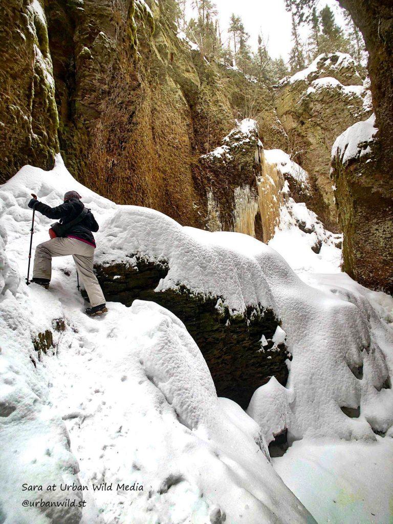 Hiking up frozen waterfall on the Kadunce River
