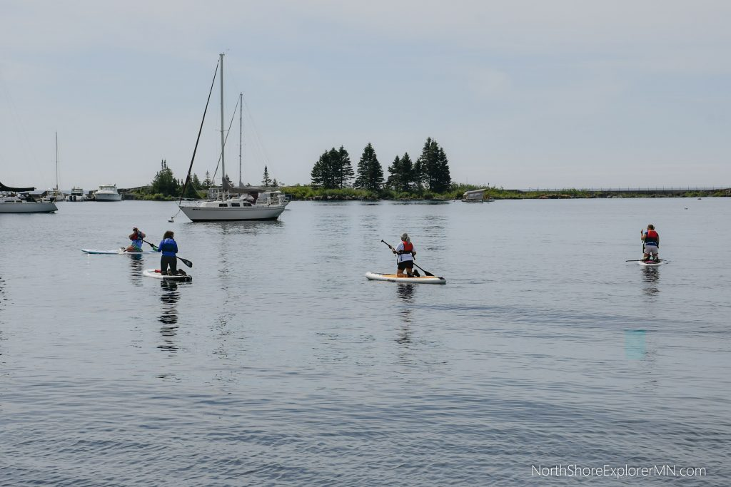learning how to stand-up-paddle-board Grand Marais, MN