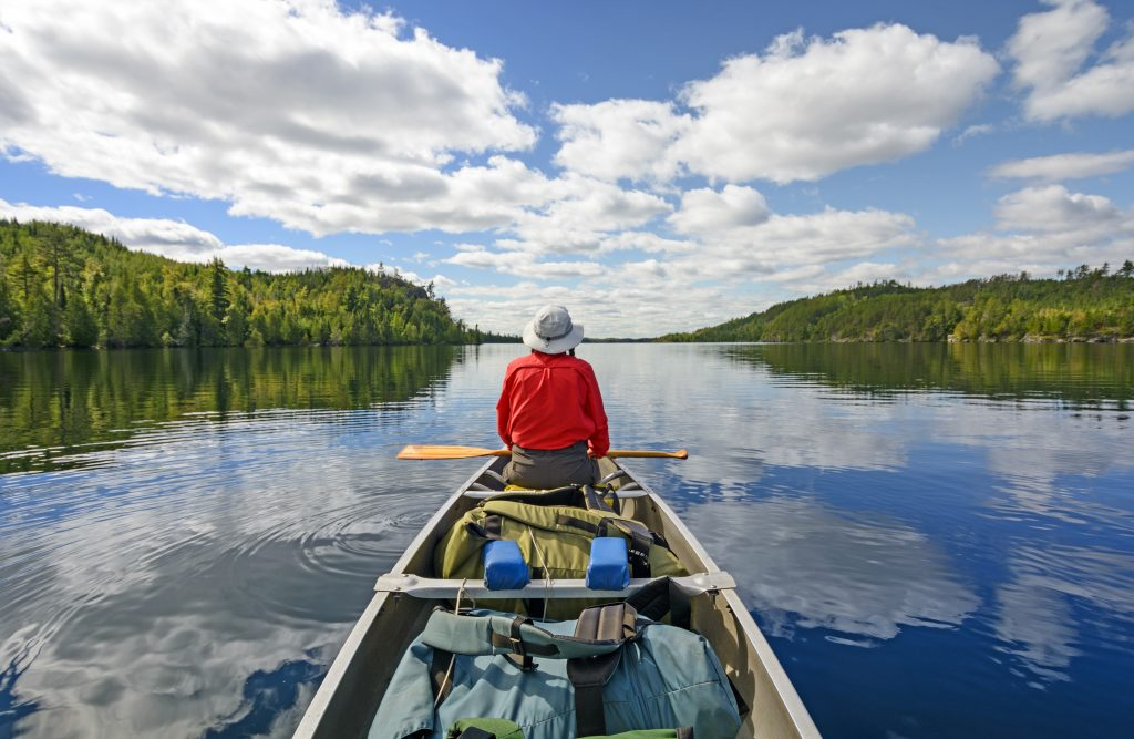 Person in a canoe in the Boundary Waters Canoe Area Wilderness BWCA